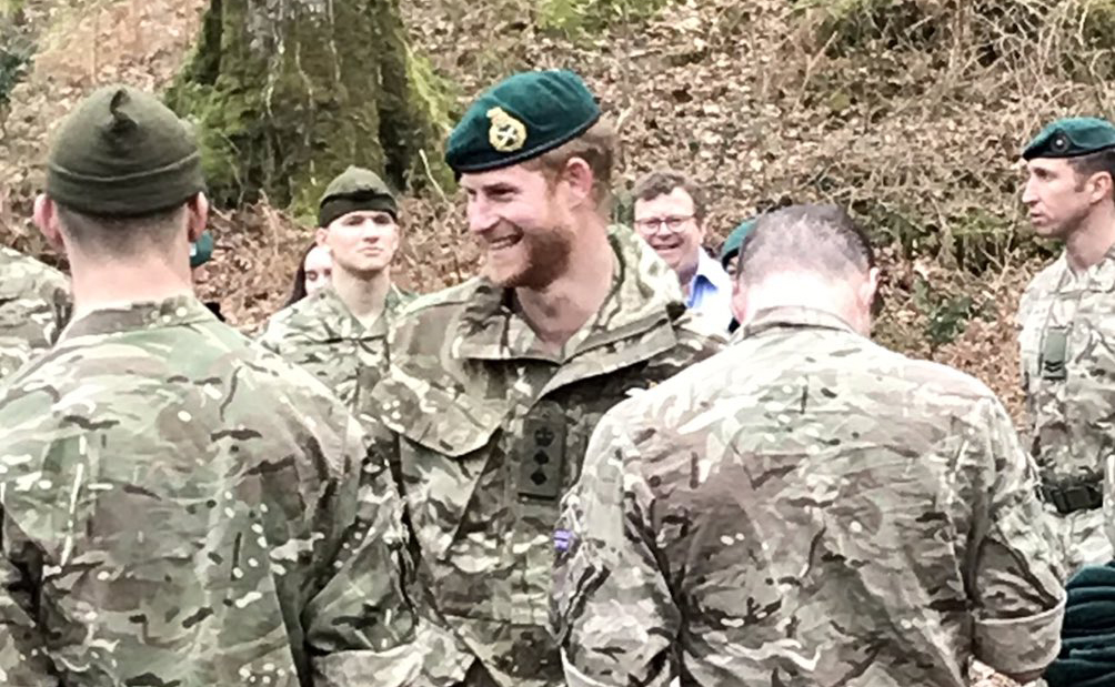 The HRH Duke of Sussex giving out green berets to new Royal Marines at Bickleigh