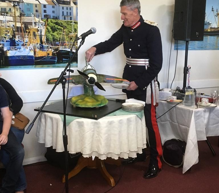 HM Lord-Lieutenant of Devon cuts commemorative spitfire cake for 75 year since D Day at Brixham